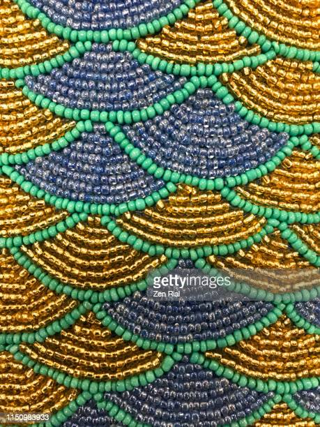 multicolored beadwork creating scallop patterns - bead stock pictures, royalty-free photos & images