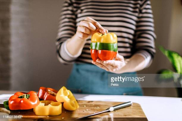 multicolored bell pepper in woman's hands - green bell pepper stock pictures, royalty-free photos & images