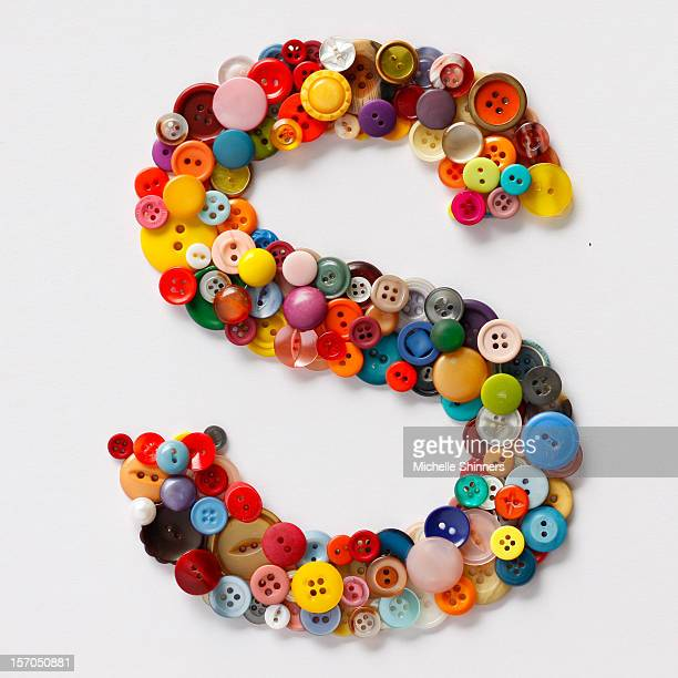 Multicolored buttons forming the letter S