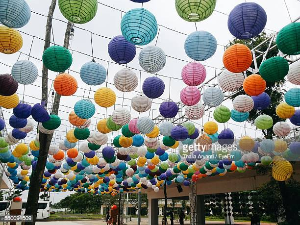 Multi-Colored Chinese Lanterns Hanging By Building