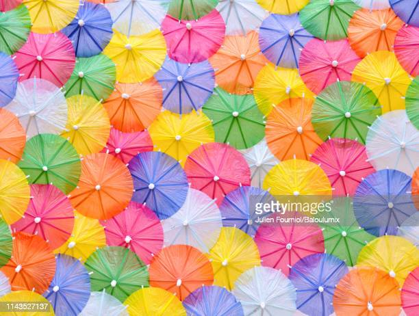 multicolored cocktail umbrellas. - cocktail party stock pictures, royalty-free photos & images