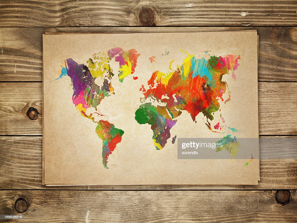 Multi-colored continents on a paper world map : Stock Photo
