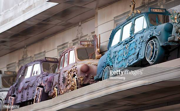 Multicolored decorated sections of London taxi cabs sit above the front windows of JCrew Group Inc's new store on Regent Street which is due to open...
