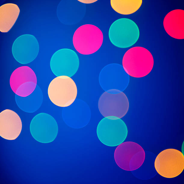Multicolored defocused lights on a blue background