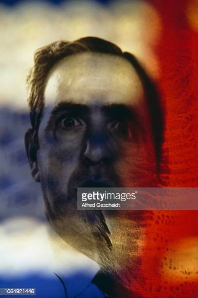 A multicolored distressed image of a distress man US 1982