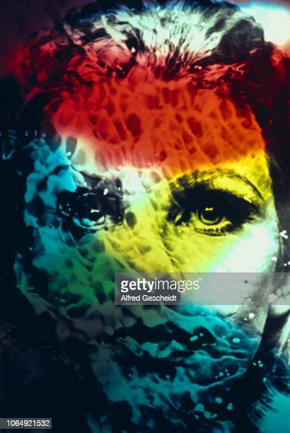 A multicolored distressed image of a young woman as if seen through water 1982