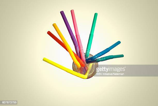 Multi-colored drinking straws in a glass