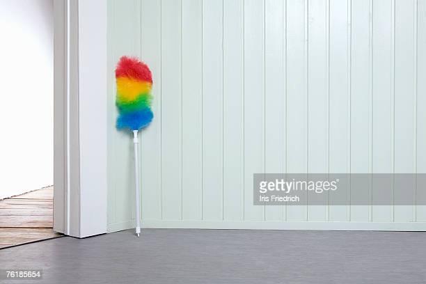 Multi-colored duster in a corner