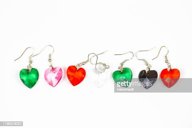 multicolored earrings heart shape over white background - jewellery stock pictures, royalty-free photos & images