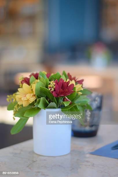 multicolored flower bouquet at a restaurant table - elena blume stock-fotos und bilder