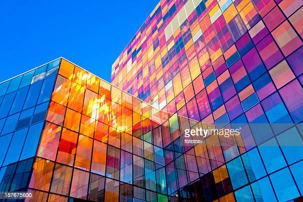 multi-colored glass wall - buildings stock pictures, royalty-free photos & images