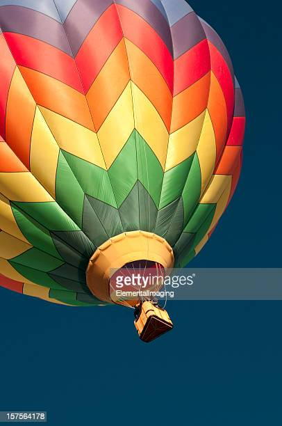 Multicolored hot air balloon isolated against the blue sky