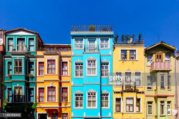 multicolored houses in a row on the street in istanbul - istanbul stock-fotos und bilder