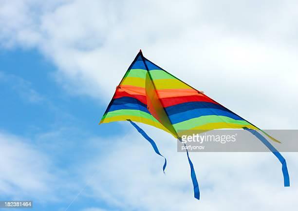 Multicolored kite in the blue sky