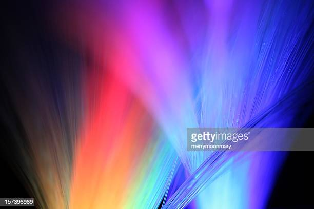 multicolored lights shining in the night - spectrum stock pictures, royalty-free photos & images