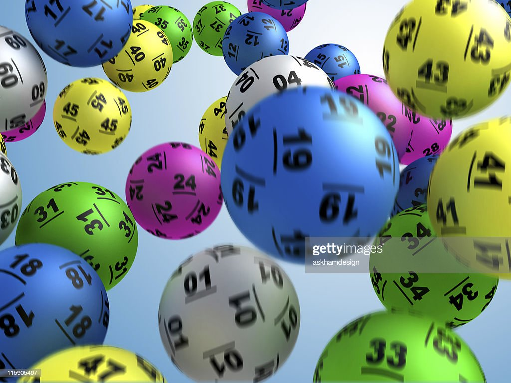 Multi-colored lottery balls suspended mid-air in flight : Stock Photo