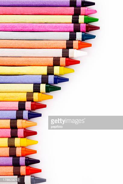 Multi-colored pencil crayons on white background