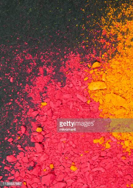 multicolored piles of pigment powder of orange and red color - chalk art equipment stock pictures, royalty-free photos & images