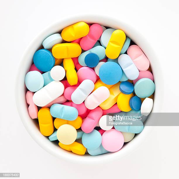 multicolored pills - nutritional supplement stock pictures, royalty-free photos & images