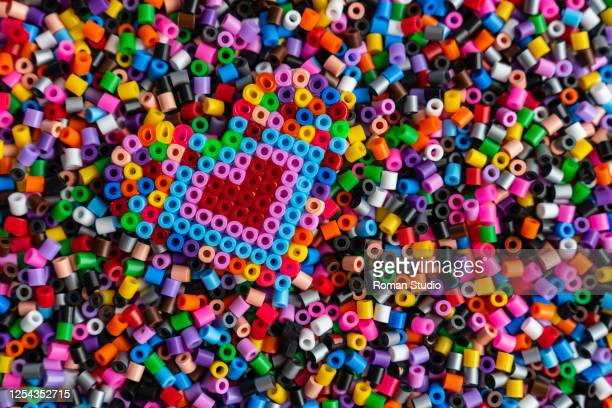 multicolored plastic beads toy for kids. heart - ビーズ ストックフォトと画像
