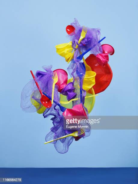 multi-colored plastic objects - plastikmaterial stock-fotos und bilder