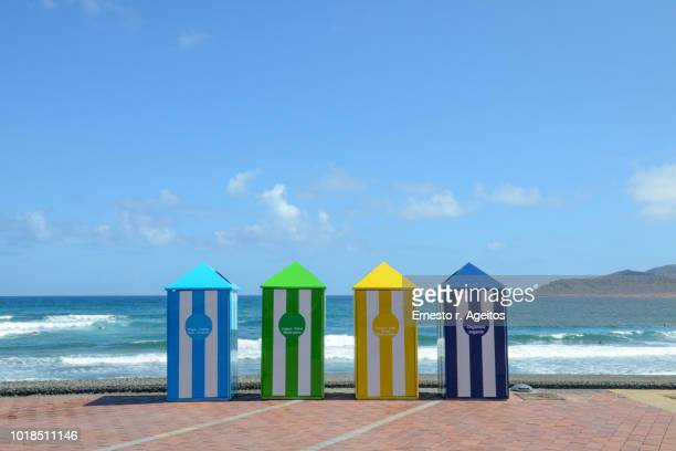 multicolored recycling bins on the promenade of las canteras beach, canary islands - atlantic islands stock pictures, royalty-free photos & images