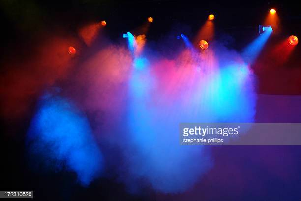 multicolored red, blue and pink stage lights with fog - stage light stock pictures, royalty-free photos & images
