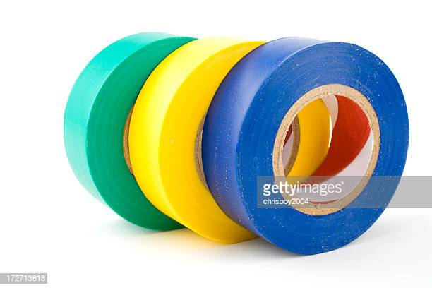 Multicolored rolls of electrical tape shingled on white