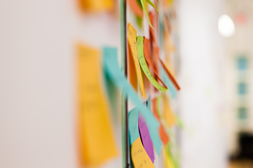 Multicolored sticky notes on whiteboard - gettyimageskorea