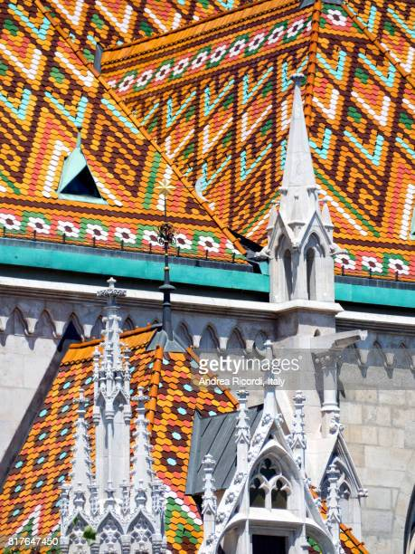multi-colored tiled roof of st matthias church, budapest,hungary - royal palace budapest stock pictures, royalty-free photos & images