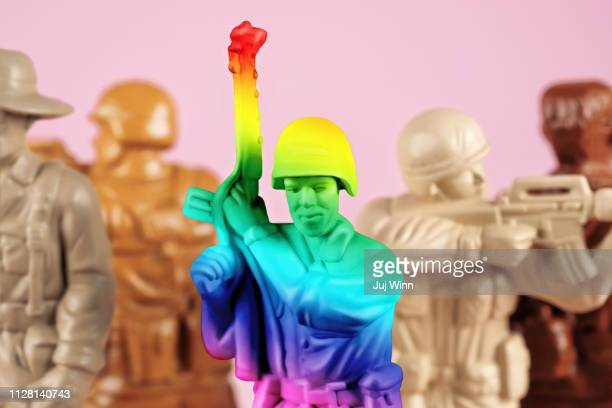 Multicolored toy soldiers representing diversity and gay people in the military.