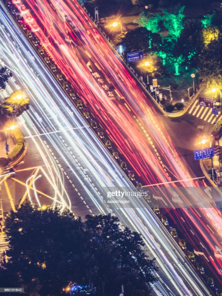 multi-colored traffic trails at night in shanghai : Stock Photo