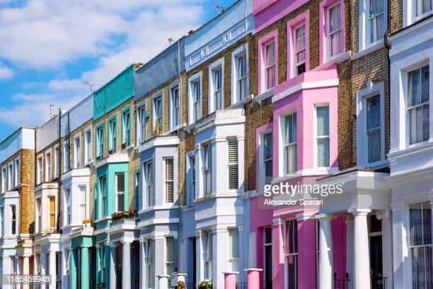 multicolored vibrant row houses in notting hill, london, uk - british culture stock pictures, royalty-free photos & images