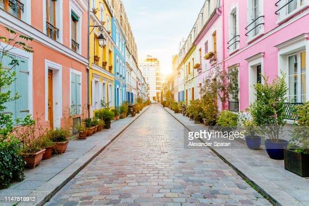 multicolored vibrant street rue cremieux at sunrise in paris, france - cobblestone stock pictures, royalty-free photos & images