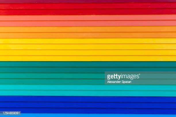 multicolored vibrant wall painted in rainbow colors - pride flag stock pictures, royalty-free photos & images