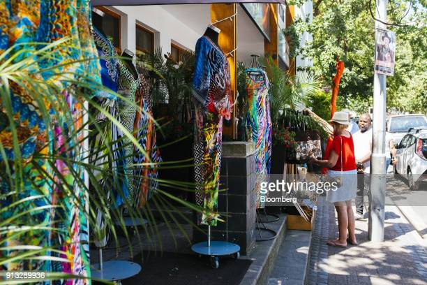 Multicolored women's clothing sits on display outside a clothing store in Stellenbosch South Africa on Friday Jan 26 2017 Markus Jooste former CEO of...