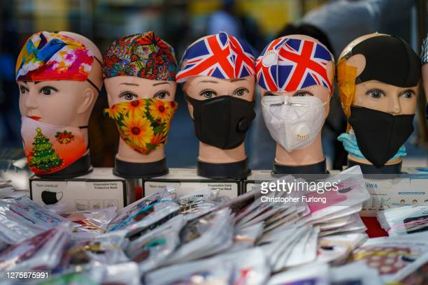 Multi-coloured and designer face masks for sale on a market stall on September 22, 2020 in West Bromwich, United Kingdom. Since easing its first...