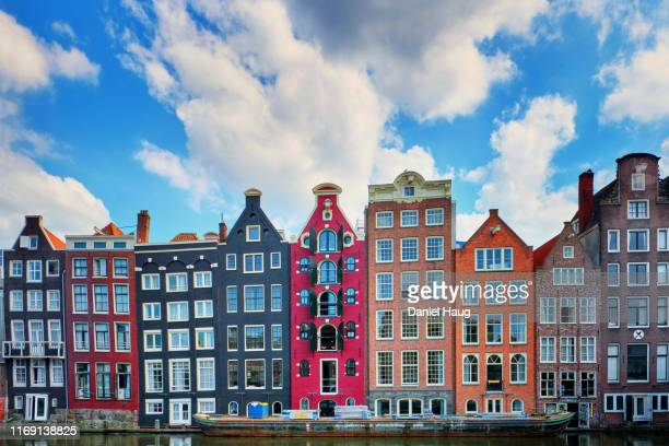 multicoloured and unique waterfront stepped gable homes in the heart of historic amsterdam - アムステルダム ストックフォトと画像