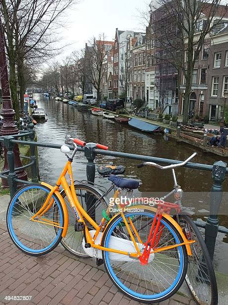 Multicoloured bicycle on bridge in canal district of Amsterdam
