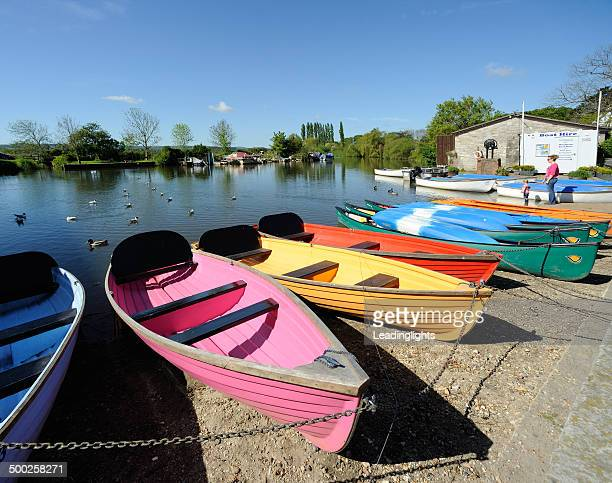 multi-coloured boats for hire - wareham stock photos and pictures