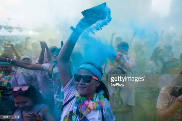 Multicoloured dyes are thrown in the air by Runners during the annual Bangkok Color Run in Bangkok Thailand on April 2 2017