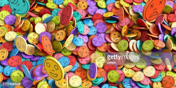 multi-coloured emoji emoticons tokens in mid-air falling into huge pile - emotion stock pictures, royalty-free photos & images