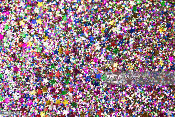 multicoloured  glitter - glitter stock pictures, royalty-free photos & images
