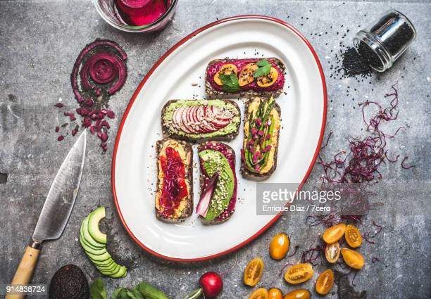 multicoloured hummus on toasts mis en place - シード ストックフォトと画像