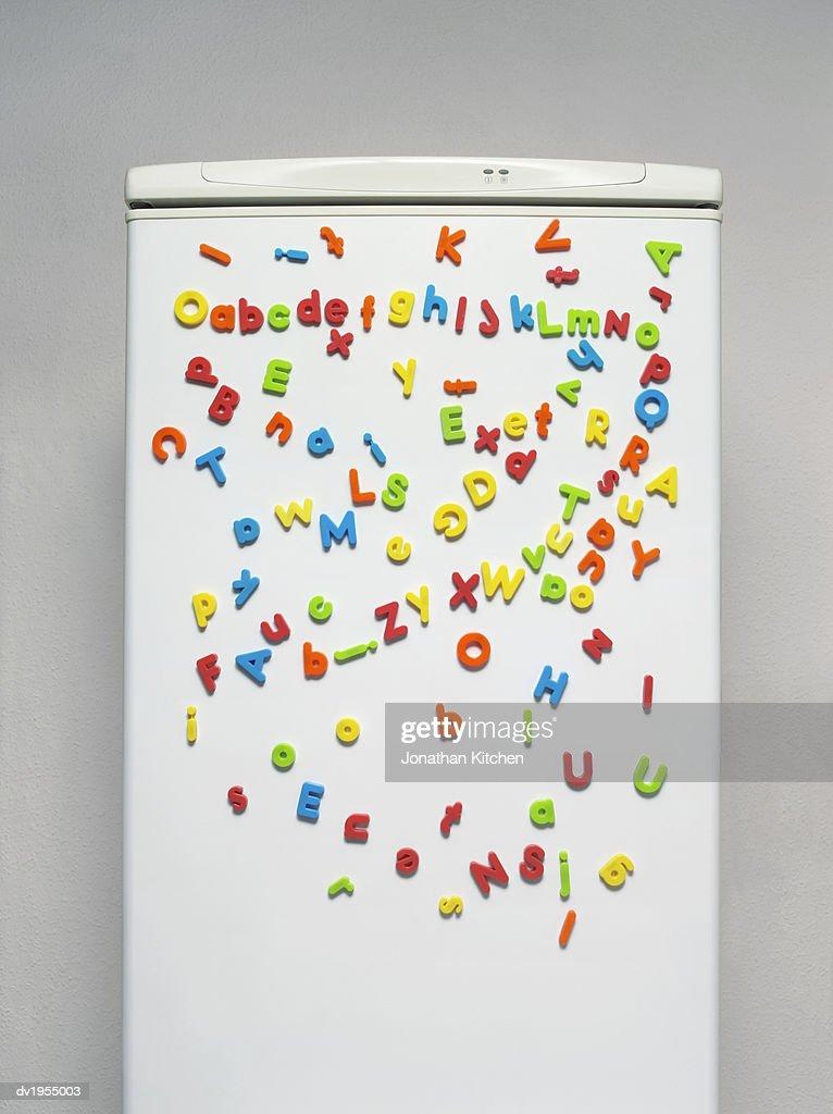 Multicoloured Magnets on a Fridge Door : Stock Photo