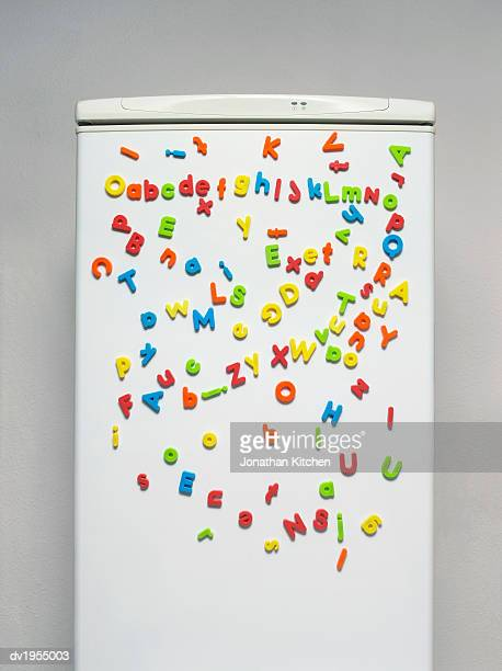 Multicoloured Magnets on a Fridge Door