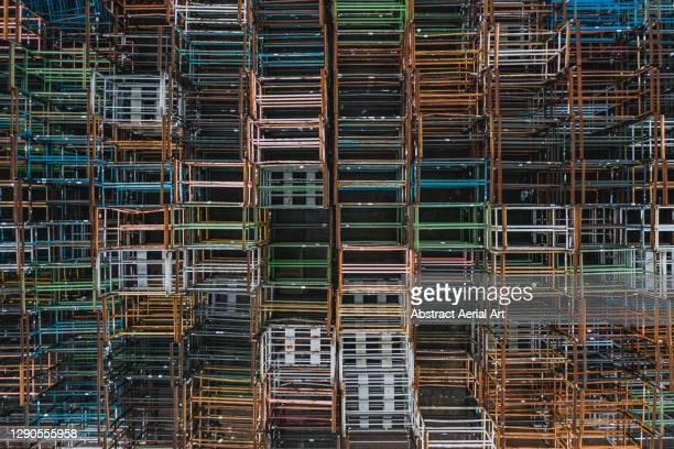 multicoloured pallets seen from directly above, england, united kingdom - pallet industrial equipment stock pictures, royalty-free photos & images