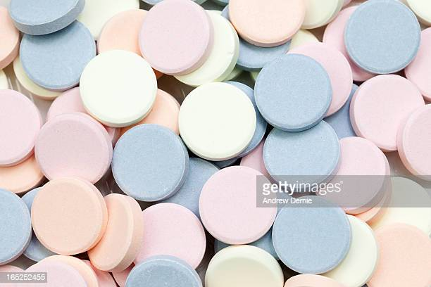 multi-coloured pills - andrew dernie stock pictures, royalty-free photos & images