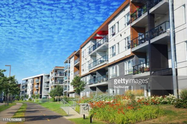 multi-condos building block with bicycles lane and pedestrian walkway - buzbuzzer stock pictures, royalty-free photos & images