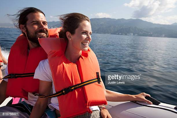 Multicultural Couple Exploring Ocean in Speed Boat